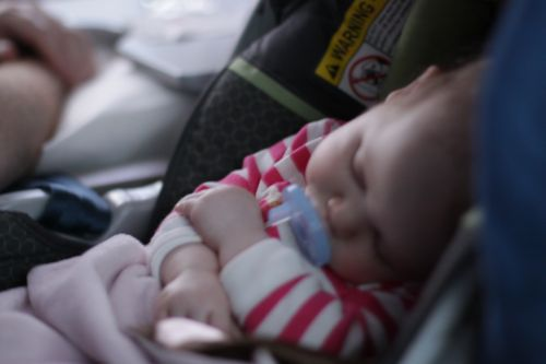 baby sleeping on airplane June Blair