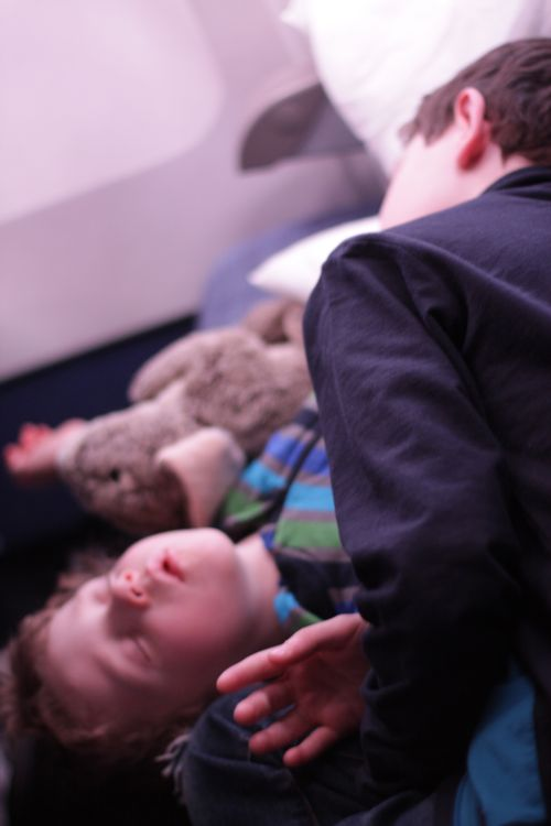 Boys sleeping on airplane Ralph, Oscar Blair