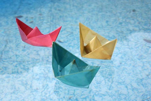 paper boats in water