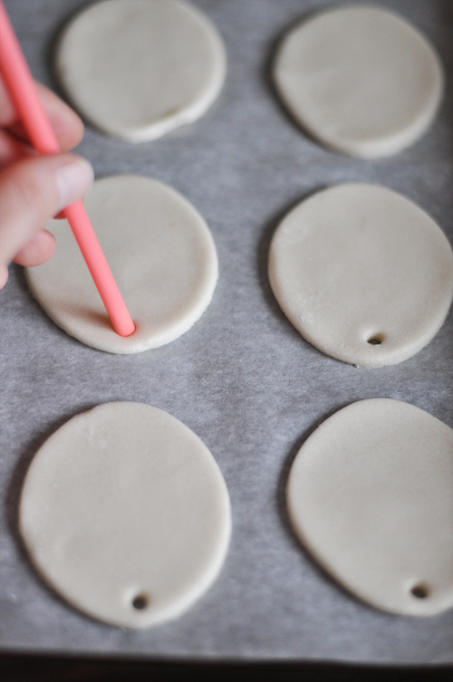 Place The Cut Outs On Parchment Covered Baking Sheets Remember To Make A Hole So You Can Hang Ornaments Straw Works Perfectly