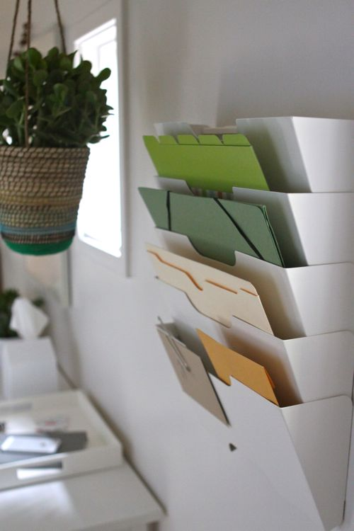 Magazine rack turned paperwork organizer.  |  Design Mom