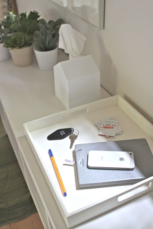 Use a tray for gathering cellphones, notebooks, keys, pens, etc. See the full Hallway Conversion on Design Mom.