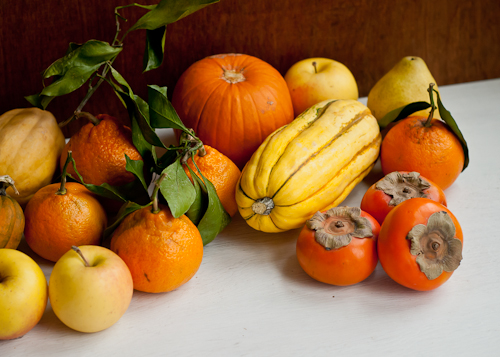 persimmons, squash, yellow apples, satsumas