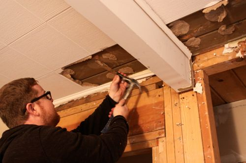 Can't get your acoustic tiles down? Stop useless scraping and use a heat gun instead.