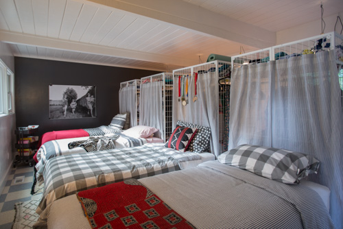 A shared bedroom for FOUR sisters. Freestanding closets separate the sleeping and dressing areas.