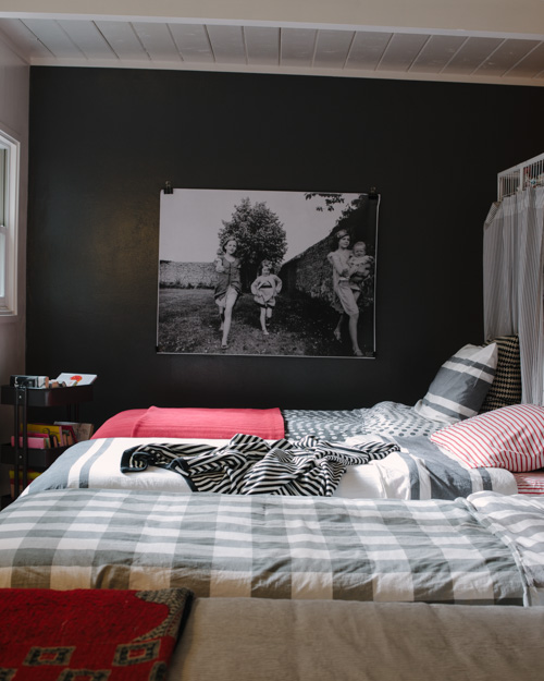A shared bedroom for FOUR sisters. Bedding coordinates but isn't matching
