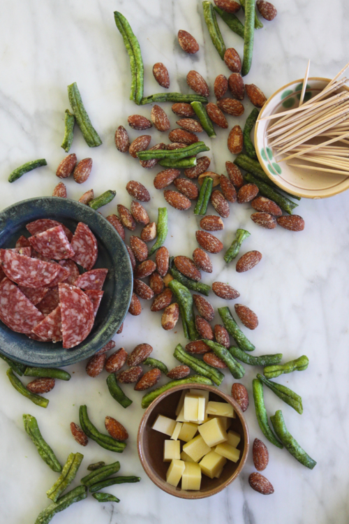"""Healthy Snack: Smokehouse Almonds + Savory Treats: Swiss Gruyere; Dried, Salted Green Beans; and Salami. In a snack-time rut? Click through for food """"pairings"""" that will spice things up!"""