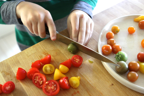 Chopping Tomatoes for a Crispy Catfish & Freekeh recipe.
