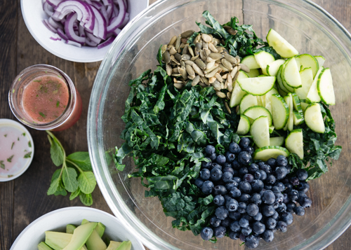 kale ribbons and ingredients for salad