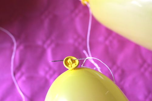 DIY Balloon Banner featured by popular lifestyle blogger, Design Mom