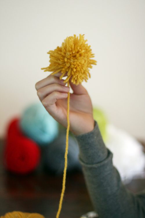 DIY pom pom yarn ball bookmark - ready for a haircut