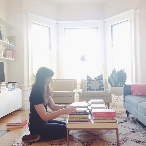 Gabrielle Blair of Design Mom arranging books