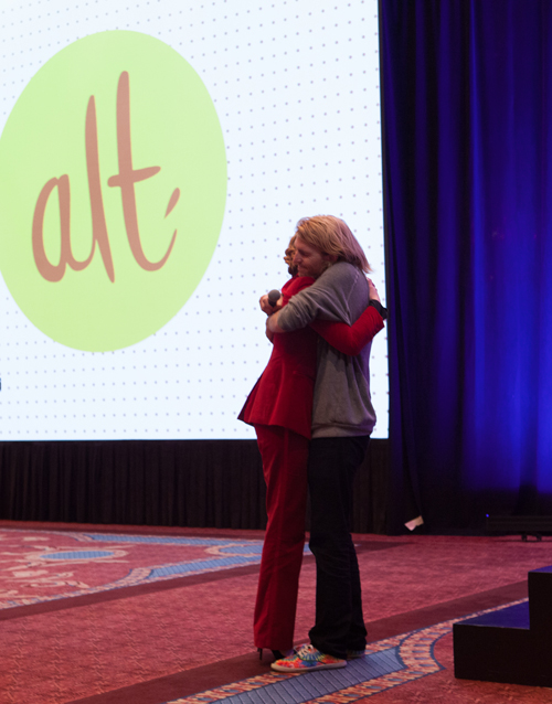 Gabrielle Blair and Dallas Clayton hugging at Alt Summit Winter 2015